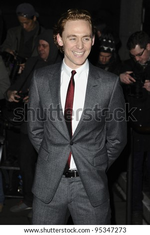 Tom Hiddlestone arrives for the arriving for the Evening Standard Film Awards, County Hall, London. 06/02/2012 Picture by: Steve Vas / Featureflash