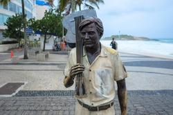 Tom Jobim conductor's statue on the edge of ipanema beach. rio de janeiro