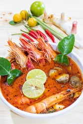 Tom Yum Kung Soup with ingredient on wooden table, Special thai food soup, Thai Dish Cuisine. Thai food.  (Hot and Sour Soup)