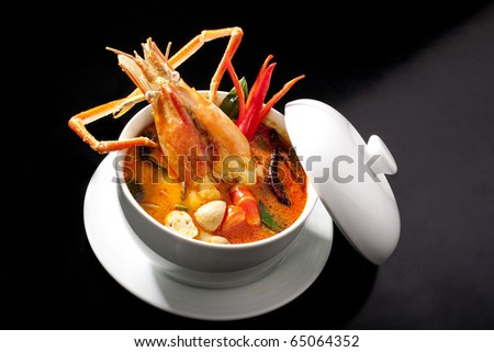 stock photo : Tom Yum spicy soup with shrimps which is known in  as tom yum