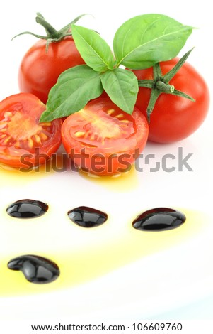 Tomato and basil garnished with olive oil and balsamic vinegar