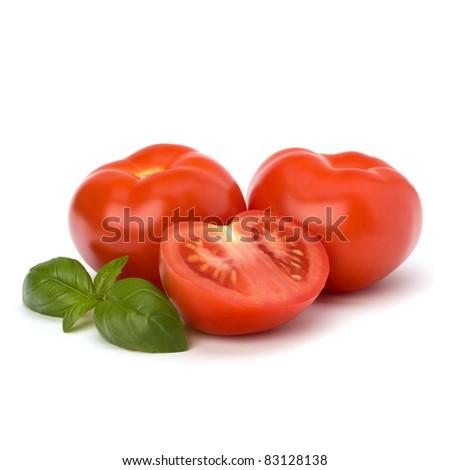 Tomato and basil leaf isolated on white background