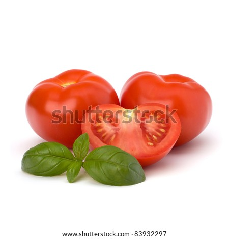 Tomato and basil leaf isolated on white background