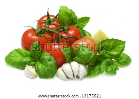 Tomato and basil with cheese and garlic on white with clipping path
