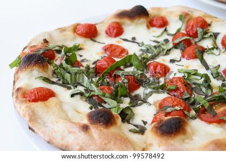 Tomato And Fresh Basil Pizza On A White Background. Stock Photo ...