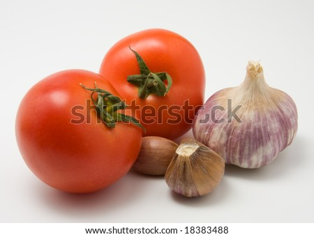 tomato and garlic close up on white