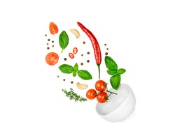 Tomato, basil, spices, chili pepper, garlic fresh thyme flying. Vegan diet food isolated on white. Falling into bowl, levitation fly. Creative concept. High quality photo