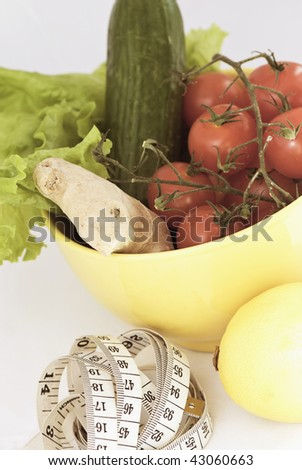 Tomato, ginger, cucumber and lemon with tape measure