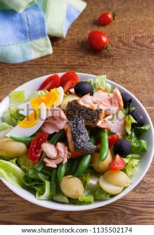 Tomato, green beans, new potato, olives and lettuce salad with salmon. Salmon fish salad. Salad Nicoise #1135502174