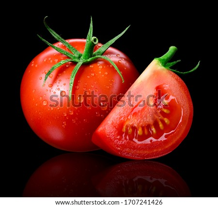 Tomato isolated. Tomato with drops on black. Tomato whole and slice side view. Wet tomato black background.