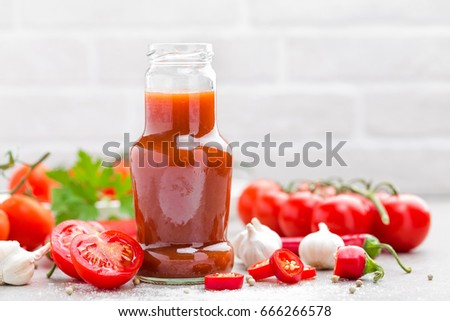 Tomato ketchup, chilli sauce, puree with chili pepper, tomatoes and garlic