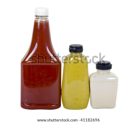 Tomato ketchup, spicy brown mustard and creamy horseradish in bottles isolated on white background