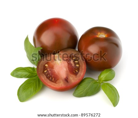 Tomato kumato and basil leaf isolated on white background