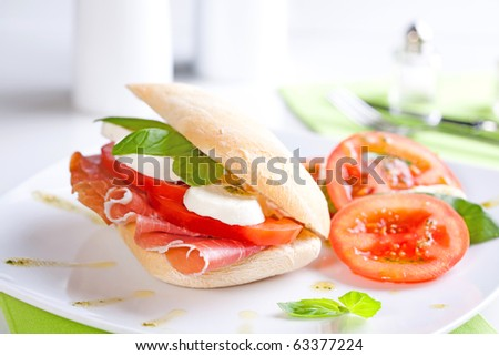 Tomato Mozzarella Sandwich with fresh basil leaves