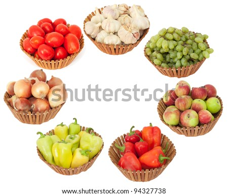 tomato, onion, garlic, peppers, apples and grapes on a white background