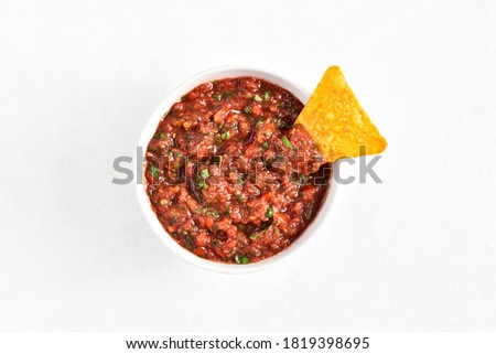 Tomato salsa in bowl over white stone background with free text space. Top view, flat lay Stock photo ©