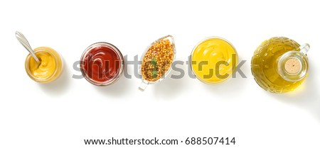 tomato sauce and mustard in bowl isolated on white background #688507414