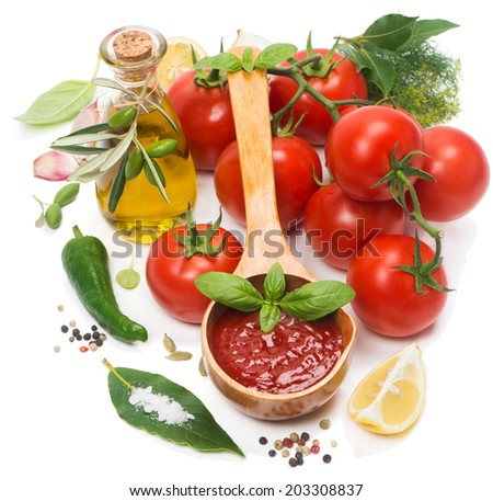 tomato sauce in a wooden spoon and fresh ingredients isolated on a white #203308837