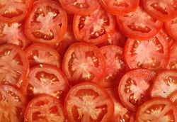 Tomato slices. Natural background with slices of tomato.