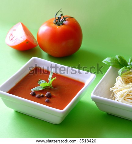 Tomato Soup - Creamy Tomato Soup With Basil Leaves And ... Cream Of Tomato Soup With Garnish