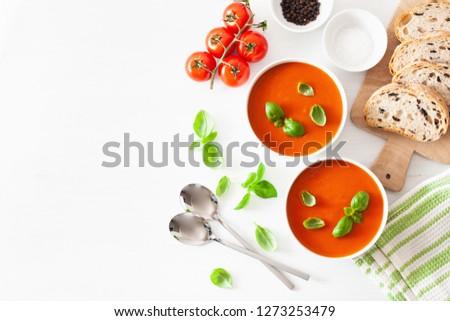 tomato soup flat lay on white backgorund
