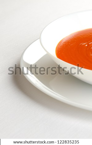 Tomato soup in a white plate