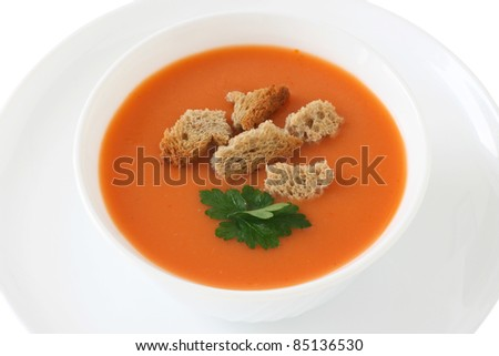 tomato soup in an white bowl