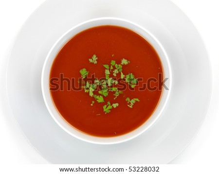 Tomato soup isolated against a white background