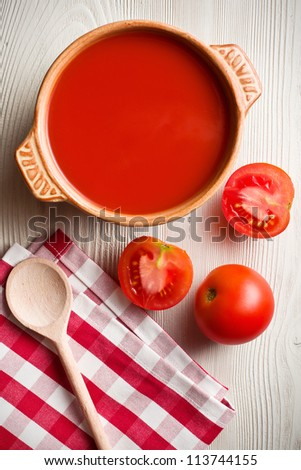 tomato soup on kitchen table. top shot