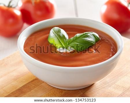 tomato soup with basil garnish.