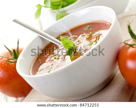 tomato soup with basil leaf on bowl