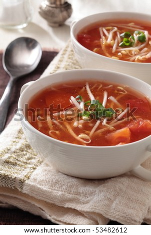 tomato soup with bean sprout in cups.