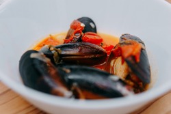 Tomato soup with mussels. The process of cooking tomato soup from mussels in a cooking class. Home-made food.
