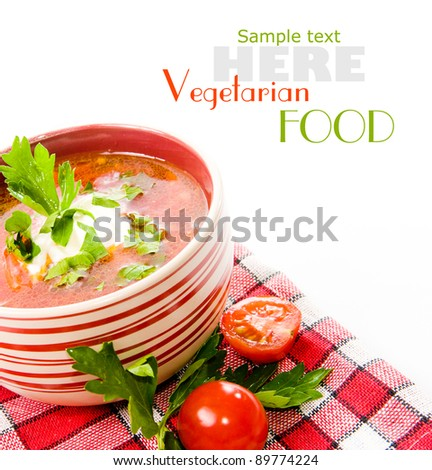 tomato soup with tomatoes in background ower white