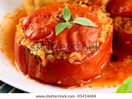 Tomato stuffed with rice and herbs closeup.