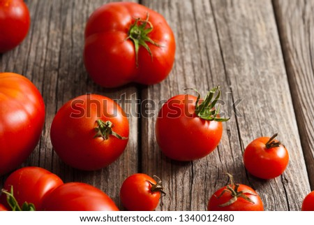 tomato variations on old wooden table