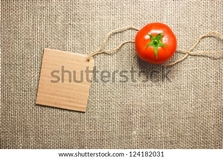 tomato vegetable and price tag on sacking background texture