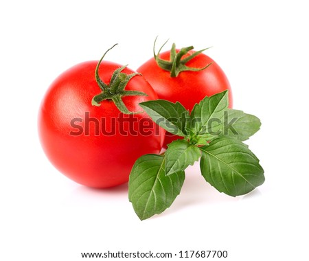 Tomato with basil - stock photo