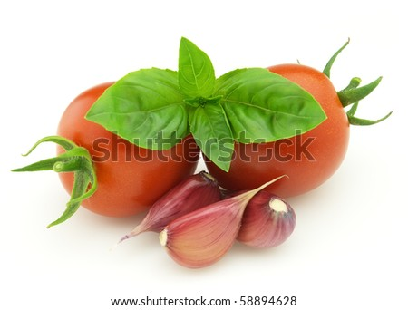 Tomato with basil and garlic - stock photo