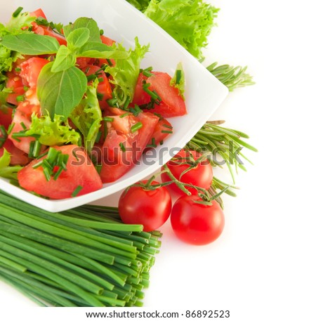 Tomatoes, an onion, pepper and salad on a white background