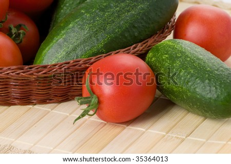 tomatoes and cucumbers in basket
