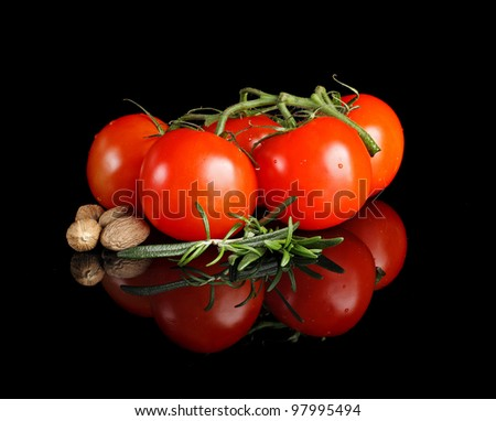 Tomatoes and garlic  on black background.