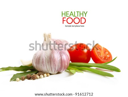 Tomatoes and garlic  on white background.