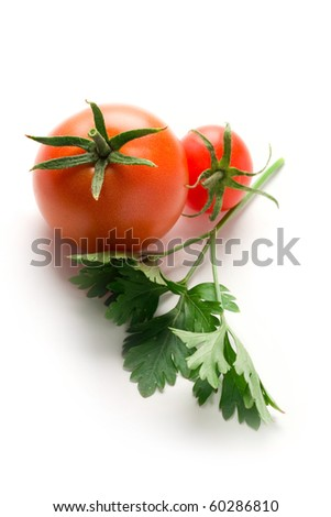 Tomatoes and parsley isolated on white