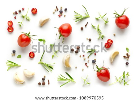 Tomatoes and various herbs and spices isolated on white background, top view