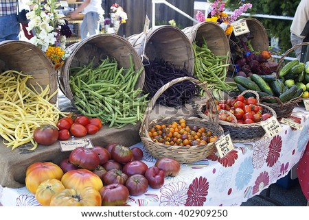 Tomatoes,beans,cucumbers, and beats for sale at a farmers market.