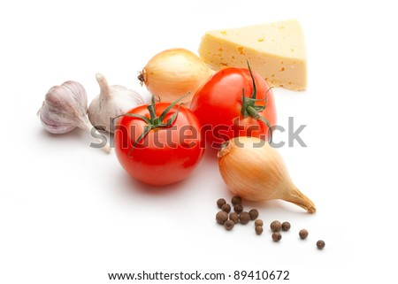 Tomatoes, cheese, onions, pepper and garlic isolated on the white background
