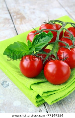 Tomatoes Cherry fresh ripe on the kitchen towel