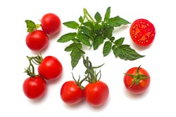 Tomatoes collection of whole and sliced with a branch of tomato leaf isolated on white background. Tasty and healthy food. Flat lay, top view