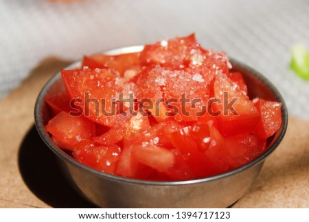 Tomatoes cut into small pieces & sprinkled sugar and salt on it .Its looks beautiful,tasty & delicious.health benefits of tomatoes include eye care, good stomach health, and a reduced blood pressure.